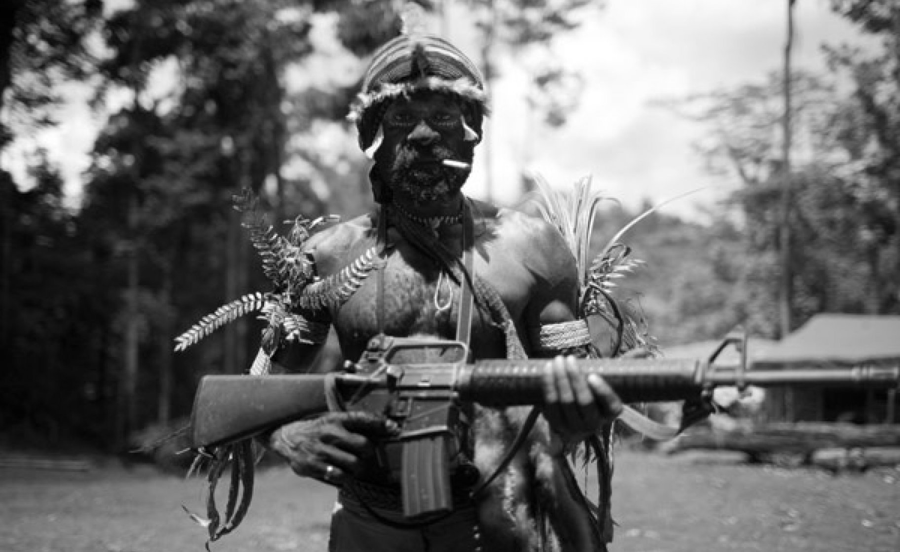 A TPN rebel at base camp in the jungle of West Papua. © KC Ortiz