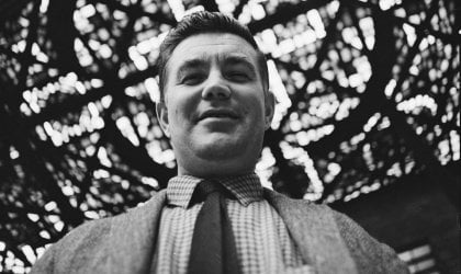 Photo of Leonard French underneath his stained glass ceiling at the National Gallery of Victoria.