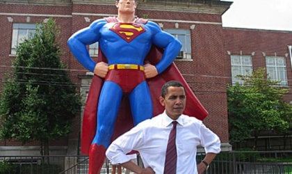 Barack Obama poses in front of the Superman Statue in Metropolis, Illinois.