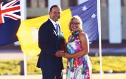Tony Abbott presents Rosie Batty with the 2015 Australian of the Year award, 25 January 2015. © Mick Tsikas / AAP