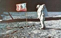Image of Buzz Aldrin next to flag on the Moon