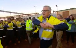 Image of Prime Minister Scott Morrison joining in with daily stretching exercises at a Fortescue Metals Group ore-processing plant in Western Australia this morning. Image via Twitter