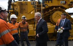Image of Prime Minister Scott Morrison and Energy Minister Angus Taylor with employees at WesTrac headquarters in Tomago, outside Newcastle, today.