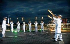 A ceremonial sunset aboard the HMAS 'Manoora' off Vanuatu in 2006. © Commonwealth of Australia