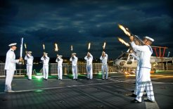 A ceremonial sunset aboard the HMAS 'Manoora' off Vanuatu in 2006. © Commonwealth of Australia