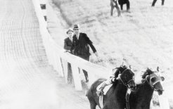 Dubbed the greatest match race in history, Seabiscuit (inside left), ridden by George Woolf, beats War Admiral in 1938. © Bettman / Corbis