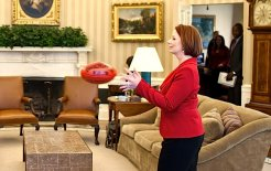 Prime Minister Julia Gillard reaches for a football during a visit to the Oval Office, 7 March 2011. © Pete Souza/The White House