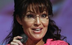 "Sarah Palin ""reloads"" at a campaign rally in Anchorage, Alaska, 2010. © John Moore / Getty Images"