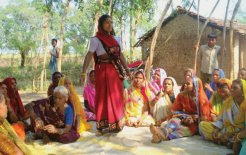 A quota success story: an elected female representative leads an Indian village meeting for local women. Courtesy of the Hunger Project.