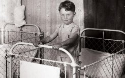 A young boy in Dalworth Children's Home at Seaforth, NSW, in the 1920s. Image courtesy of the State Library of NSW. Photograph: Sam Hood