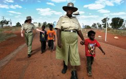 Police officer Gwen Brown watches over the community in Ali Currung, Northern Territory, 2007. © Chris Crerar / Newspix / News Limited