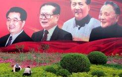 Women tend a garden under the gaze of history. FROM LEFT: Hu Jintao, Jiang Zemin, Mao Zedong and Deng Xiaoping. © Reuters/Stringer Shanghai